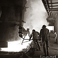 Men Working Blast Furnace At Steel by H. Armstrong Roberts/ClassicStock