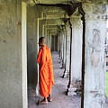 Monk Among The Ruins At Angkor Wat, Cambodia by John Cumbow
