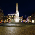 Monument On The Dam In Amsterdam Netherlands At Night by Nisangha Ji