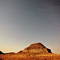 Moon Lit Castle Butte And Star Tracks In Scenic Saskatchewan by Mark Duffy