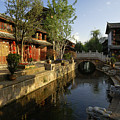 Morning Comes To Lijiang Ancient Town by Michele Burgess