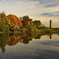 Morning Reflections Of Autumn Colours On A Farm Pond by Mark Emmerson