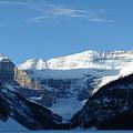 Morning Sunshine Kisses Snowy Peaks by Greg Hammond