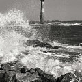 Morris Island Lighthouse Waves Against Rocks by Donnie Whitaker