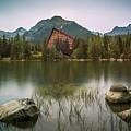 Mountain Lake Under Peaks by Karol Czinege
