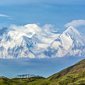 Mt Mckinley Materializes Out Of The Clouds. by Claudia Abbott