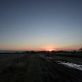 Muddy Road Sunrise by JG Thompson