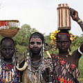 Mursi Tribesmen In Ethiopia by Gilad Flesch
