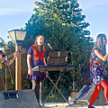 Musical Entertainers In Central Park In Bariloche-argentina by Ruth Hager