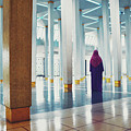 Muslim Woman Dressed In The Traditional Islam Clothing Standing Inside National Mosque In Malaysia by Srdjan Kirtic