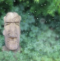 Mysterious Stone Statue In Garden by Susan Vineyard