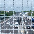 Narrow Depth Of Field Looking Down From Railing Onto Busy Highway by Alexandre Rotenberg