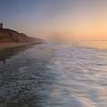 Nauset Light On The Shoreline Of Nauset by Michael Melford