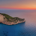 Navagio Beach - Shipwreck Cove At Sunset by Kelvin Trundle