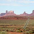 Navajo Flag At Monument Valley by Suzanne Oesterling