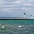Navigational Aids On Lake Michigan In Manistee by Sue Smith