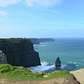 Needle Rock Formation With Blue Skies On The Cliff's Of Moher by DejaVu Designs