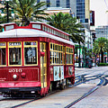 New Orleans Canal Streetcars  by Chuck Kuhn