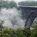 New River Gorge Bridge On A Foggy Day In West Virginia by Brendan Reals