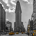 New York - Flatiron Building And Yellow Cabs - 2 by Christian Tuk