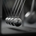 Newton's Cradle In Motion - Metallic Balls by N.J. Simrick