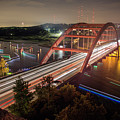 Nighttime Boats Cruise Up And Down The Loop 360 Bridge, A Boaters Paradise With Activities That Include Boating, Fishing, Swimming And Picnicking - Stock Image by Austin Welcome Center