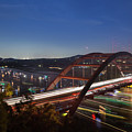 Nighttime Boats Leave Colorful Streaks As They Cruise Up And Down Lake Austin Below The 360 Pennybacker Bridge by Austin Welcome Center