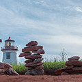 North Cape Lighthouse Behind Stone Cairns by Chris Bordeleau