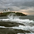 Nubble Light In A Storm by Rick Frost