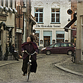 Nun On A Bicycle In Bruges by Joan Carroll