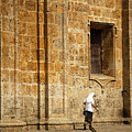 Nun Walking In Front Of Cathedral by A Cappellari