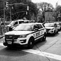 nypd police patrol vehicles parked at columbus circle New York City USA by Joe Fox