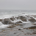 Ocean Waves Over Rocks by Frank Stallone