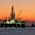 Oil Rig And Supply Boat After Sundown by Bradford Martin
