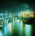 Oil Tanker In Port At Night. by David Parker