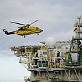 Oil Worker Helicopter Landing On Rig. by Bradford Martin