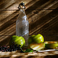 Old Bottle With Green Apples by Sandra Cunningham