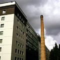 Old Brick Chimney Amongst Modern Office Buildings Near The Railway Station Perugia Umbria Italy by Michael Walters