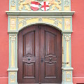 Old Door And Emblem by Christiane Schulze Art And Photography
