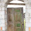 Old Door In A Brick Wall by Robert Hamm
