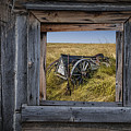 Old Farm Wagon Viewed Through A Barn Window by Randall Nyhof