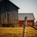 Old Fence With A Red Barn by David Jilek