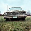 Old Ford Sedan In The Field by Edward Fielding