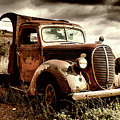 Old Ford Truck In Desert by Miles Whittingham