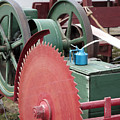 Old Gas Engine And Saw Blade At A County Fair by William Kuta