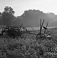 Old Hay Baler In Misty Field by H Armstrong Roberts and ClassicStock