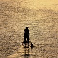 Old Man Paddling Into The Sunset by M C Hood