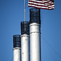 Old Mill Smoke Stacks With Flag by Mike Albright