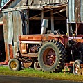 Old Red Tractor And The Barn by Michael Thomas