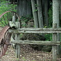 Old Rusty Wagon Wheels And Weathered Fence by Anita Hiltz